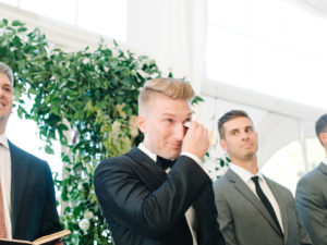groom crying first look